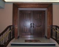 Veneered heritage fire door set with raised panels.