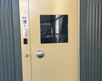 External secure door with frame mounted custodial lock
