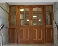 Heritage fire door set with raised bollection panels and glazed sidelights.