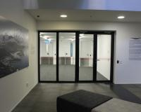 Forster steel glazed fire door with fire rated sidelights.