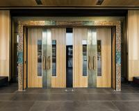Tasmanian Oak veneered doors with Brass push plates